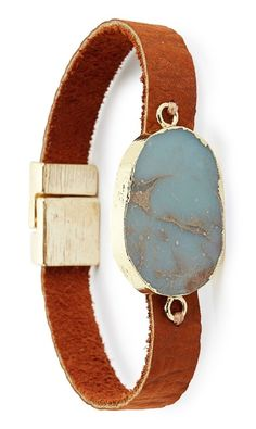 A marbled jasper stone sits atop this slender leather bracelet, adding beautiful embellishment to the boho-chic style.