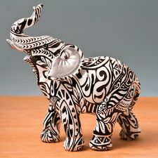 Features:  -An ideal gift for an elephant collector!.  -Beautiful black and white swirl pattern.  Product Type: -Figurine.  Style: -Asian Inspired.  Theme: -Animal.  Handmade: -Yes.  Primary Material: