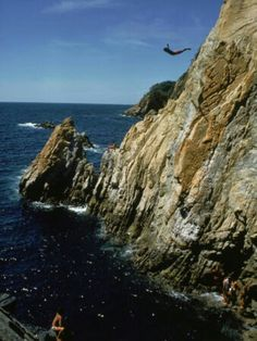 Cliff Dive off a high cliff or tall bridge. To give me adrenaline and a chance to be spontaneous.