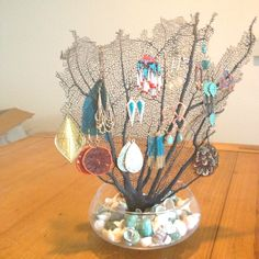 This is a sea fan I found on a beach in puerto rico. To make it stand I used e6000 glue, a low glass bowl and bag of seashells, all found at Joann. Make sure to wait for glue to dry before filling with shells. Then use it for earrings!