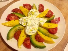 One of my favorite summer lunch! Fruit salad of Organic Mangos, Avocados, Tomatoes w fresh Italian burrata cheese. So creamy yet healthy decadent and delicious! Yes! avocados and tomatoes are fruits :)