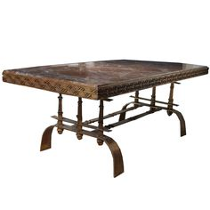 Art Deco Table, After Mont  United States  Circa 1940  Art Deco wrought-iron gilt-decorated dining table with inset marble top, a fusion of Asian effects and Miesian silhouettes.  From the early 1930s and into the 1960s a few designers stand out who work in wrought iron with related silhouettes, namely Poillerat, Subes, and Mont. Their forte was creating furniture that offered a stylish, dramatic, yet modern, take on historical forms and details.
