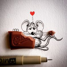 Adorable Cartoon Mouse Steps Outside Comfort Zone And Into Reality Theres more to a cartoon character than just a story as this cute mouse proves. Self-taught Swiss illustrator Loïc aka apredart brings his charming comic character called Rikki alive by drawing funny scenarios with a touch of reality - using 3D everyday objects. The witty minimalist and oddly engaging series of cartoons show the shenanigans of this little mouse as it timidly steps out from the page to the outside world.  The…