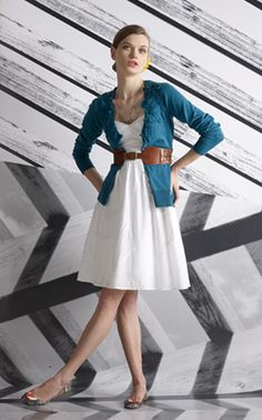 cardi with belt on the outside of ensemble over an a-line dress with a great flat.