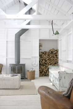 wood stove with curved pipe and wood storage