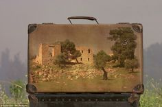 Memory Suitcases.  Israeli photographer Yuval Yairiuses worn, vintage suitcases as canvases for photos he's taken. Gloucestershire Resource Centre http://www.grcltd.org/scrapstore/