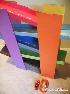 I was inspired by a toy I saw in a toy catalog for this race track. Materials: 4 23″ diaper carton lids for columns. 5 16″ cardboard piece for tracks. Fold the sides up to make curbs./li> A lot of colored construction paper Glue Toy cars (preferably flat and heavy) Directions: I used the dimensions …