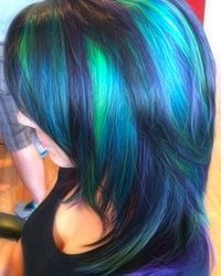 Peacock-like dyed hair color -- blue & green & purple highlights / streaks