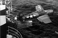 A U.S. Navy Grumman F6F-3 Hellcat fighter of fighting squadron VF-2 being catapulted from the aircaft carrier USS Hornet (CV-12) via the hangar catapult, 25 February 1944.