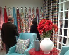 Hanging fabrics samples displayed at the Robert Allan showroom