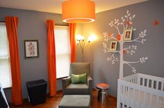 Sweet and subtle #orange touches in this neutral #gray #nursery.  #treedecal #orangecurtains