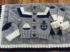 Little Coffee Bean Cardigan from www.thebrownstitch.com with duplicate stitch the boat and anchor.