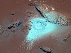 Sulfur-rich rocks in the Columbia Hills on Mars stand out in bright blue in this false-color image from the Spirit rover. Spirit used its rock abrasion tool, or RAT, to grind a hole in the rock. The rock's high sulfur content and softness are probably evidence of past alteration by water.