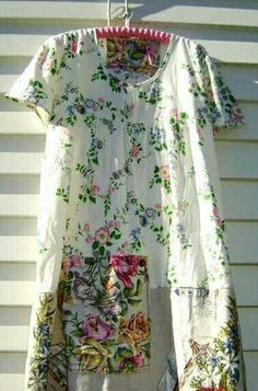 Gardening dress, sewn of sweet, contrasting floral fabrics...