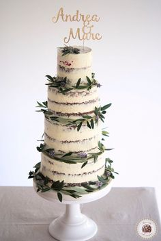 Tuscan Semi Naked Wedding Cake     Tuscan-inspired cake, decorated with olive branches and lavender for wedding at @masialagarriga