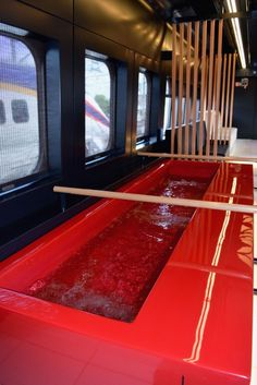 The interior of the footbath car on East Japan Railway Co.'s new 'Toreiyu Tsubasa' train on June 30, 2014 in Yamagata, Japan. Passengers will be able to relieve aching feet with a 2.4-meter-long footbath, and then congregate in a lounge for drinks, on the Yamagata Shinkansen Line starting July 19 for a limited run until September.