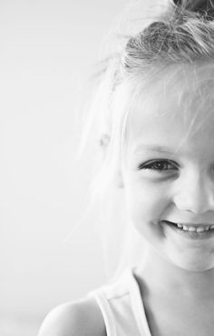 Black and white child photography with unique framing.