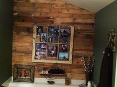 Pallet wall in bathroom with old window as picture frame!