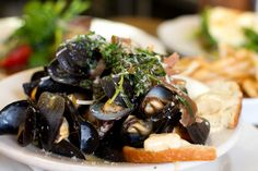 P.E.I. mussels steamed in white wine, fennel, and fresh herbs, served with pomme frites and roasted garlic aioli