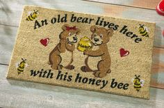 Honey Bears Welcome Mat. I want to try making one of these with a store bought mat & some paints. wonder if it will work.