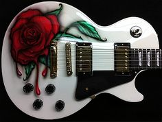 Gibson Les Paul that we refinished in Alpine White w/ a Rose graphic. We specialize in guitar painting. Contact us today for a quote to have your guitar painted Acoustic Guitar For Sale, Prs Guitar, Guitar Art, Music Guitar, Cool Guitar, Guitar Logo, Guitar Tattoo, Epiphone Les Paul, Les Paul Custom