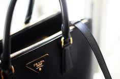 ; Prada Saffiano Lux - just need to find the color I want. Oh and the right size to get.