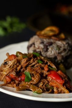 Amazingly tasty authentic Cuban Ropa Vieja recipe. Carribean aroma in your kitchen! #cuba #beef | cookingtheglobe.com