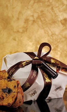 Chocolate Panettone - An Italian tradition! Panettone, the tall, cylindrical, fruit-filled sweet bread from Milan has become an essential part of the Christmas season.