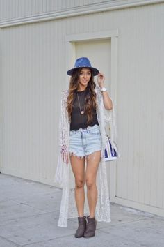 26 Ways to Style a Kimono for Spring - gorgeous lace kimono with fringe trim on the sleeves, styled with denim cut-off shorts, a sheer top, and brown leather ankle boots