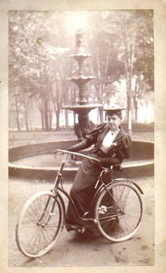 Woman with bicycle, 1890s.