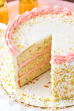 Strawberry Champagne Layer Cake - layers of moist champagne cake with fresh strawberry frosting! From Life, Love, and Sugar.