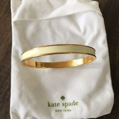 Kate Spade cream and Gold bracelet/bangle  Cream/white and Gold bangle / bracelet - new with Box! Awesome for stacking! See closet for other Kate spade Bracelets!! kate spade Jewelry Bracelets