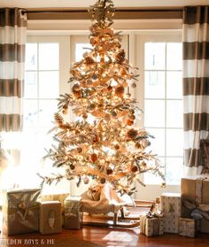 Flocked tree with glittery bronze, gold, silver ornaments - Golden Boys and Me Holiday Home Tour 2017