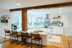 Mosaic tile backsplash and white cabinets give the homeowners a beach inspired kitchen without being too themed. #fixerupper #magnoliafarms #joannagaines #magnoliahomes