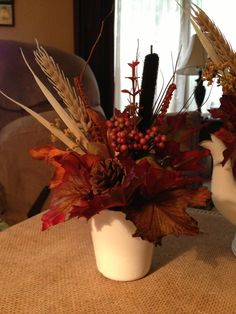 Granite ware cup with fall arrangement