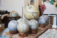 Mini Desk Globes and an Ochre Livingstone desk globe in Bellerby & Co's London studio. (Photo: Ana Santl)