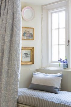 Beautiful window seat in a country bedroom. Cabbages and Roses Elephant Stripe…