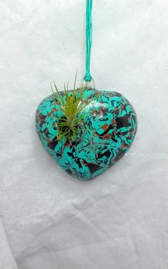 Check out this item in my Etsy shop https://www.etsy.com/listing/244286037/turquoise-polymer-clay-hanging-heart