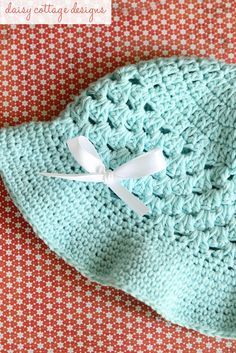 This adorable FREE! sun hat is perfect for spring and summer. This particular hat fits girls ages 4-8. Make it using 100% cotton yarn so it's cool and breathable in the warmer months.