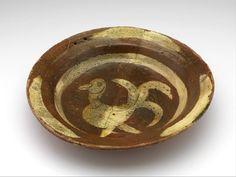 dish 1375 - 1450 Dimensions diam. 30.1 cm Material and technique slip decoration, lead glaze, redware