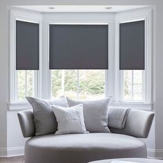 Geometric patterned roman blinds in a bay window home decor our custom roller shades come in fabric or vinyl and are easy to install light filtering room darkening blackout or cordless options available sisterspd