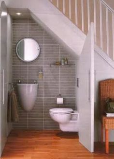 Tiny bathroom under the stairs. Great idea if you put in the turning steps up to the loft in the tiny house Tiny bathroom under the stairs. Great idea if you put in the turning steps up to the loft in the tiny house Space Under Stairs, Bathroom Under Stairs, Under The Stairs Toilet, Staircase For Small Spaces, Down Stairs Toilet Ideas, Closet Ideas For Small Spaces, Interior Design Ideas For Small Spaces, Space Saving Ideas For Home, Closet Under Stairs
