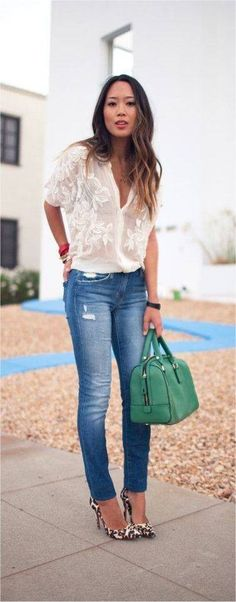 Jeans, beautiful flowering ivory blouse, high heels and a big colorful handbag. Ready, sexy and beautiful for Spring!
