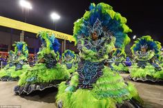 Team of dancers:In Sao Paulo, Brazil's most populous city and its economic capital, carnival celebrations were kicked off under intermittent summer rain, with a tribute to Carlinhos de Jesus, one of Brazil's most famous salon dancers