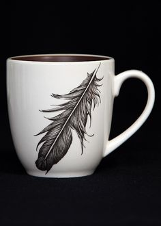 raven feather mug. $42 Laura Zindel design... I would never pay this much for a mug but gosh it's purdy