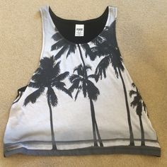 PINK tank top Pink tank top with palm trees! Worn only a few times. It is in good condition PINK Victoria's Secret Tops Tank Tops