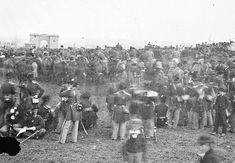 Picture of Union soldiers in their dress uniforms for the Gettysburg National Cemetery Dedication Ceremony where Lincoln gave the Gettysburg Address on November 19, 1863. In the distance can be seen the Evergreen Cemetery Gatehouse.