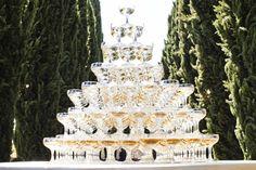 Pyramid of Champagne    Photography: Marc Royce Photography   Read More:  http://www.insideweddings.com/weddings/courtney-bingham-and-nikki-sixx/573/