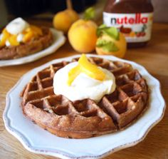 Nutella Waffles - whaaattt..  1 batch of waffle batter (made per package instructions)  1/3 cup nutella  1 cup heavy whipping cream  1 TBSP brown sugar  1 peach  simply mix the nutella with the waffle batter and if you wanna try marble then just have a separte bowl with the nutella mixed in