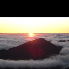 Haleakala beautiful sunrise. Then rode the bike back down the hill. Absolutely beautiful landscape.
